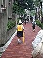 Two schoolkids wearing hats and randoseru; June 2007.jpg