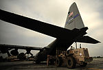 U.S. Airmen load supplies onto a C-130H Hercules aircraft from the 746th Expeditionary Airlift Squadron at Bagram Airfield, Afghanistan, in support of relief efforts for Pakistan Aug. 20, 2010 100822-F-KV470-171.jpg