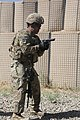U.S. Army Sgt. 1st Class Edwin Ramos, an adviser with the 10th Mountain Division, holds his M9 Beretta pistol at the pistol-ready position while facing downrange at Khair Kot Garrison, Paktika province 130606-A-NQ567-117.jpg