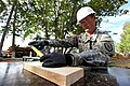 U.S. Army Sgt. 1st Class Michael Gegenheimer, the construction site noncommissioned officer in charge with the 176th Engineer Company, 96th Troop Command, Washington Army National Guard, measures lumber during 130727-M-MG222-005.jpg