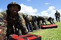 U.S. Marine Corps Gunnery Sgt. Chad Fordyce, standing at right, looks on as members of the Royal Barbados Defense Force participate in a team-building drill during a martial arts program in Bridgetown, Barbados 100820-N-EP471-136.jpg