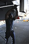 U.S. Navy Aviation Structural Mechanic Airman Kevon Mitchel performs maintenance on an F-A-18E Super Hornet aircraft assigned to Strike Fighter Squadron (VFA) 147 in the hangar bay of the aircraft carrier USS 130601-N-TX484-072.jpg