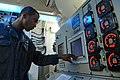 U.S. Navy Electrician's Mate 2nd Class Glen Nassy checks readings of the ship's electrical plant aboard the guided missile destroyer USS McCampbell (DDG 85) in the Pacific Ocean March 6, 2013 130306-N-TG831-009.jpg