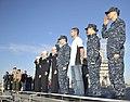 U.S. Sailors and Marines salute as the aircraft carrier USS Nimitz (CVN 68) arrives at Naval Air Station North Island, Calif., Dec. 12, 2013 131212-N-JC752-426.jpg