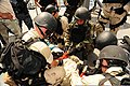U.S. Sailors assigned to a visit, board, search and seizure team and members of the Royal Jordanian Navy attend to a simulated casualty during a bilateral training exercise aboard the amphibious dock landing 120514-N-XO436-268.jpg