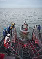 USS Monsoon launches a rigid-hull inflatable boat..jpg