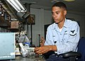 US Navy 030618-N-3970R-013 Aviation Electrician Technician 3rd Class Andre Moore test a fuel shot off valve.jpg