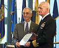 US Navy 031107-N-2338M-001 Rear Adm. Donald Arthur, National Naval Medical Center (NNMC) Commander, receives a Meritorious Unit Commendation from Secretary of the Navy, the Honorable Gordon England on behalf of the staff member.jpg
