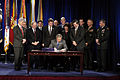 US Navy 031124-D-2987S-056 President George W. Bush signs the Defense Authorization Bill at the Pentagon on Nov. 24, 2003.jpg