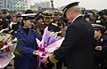 US Navy 040224-N-3931M-119 Vice Adm. Robert Willard, Commander U.S. Seventh Fleet, receives a traditional greeting of flowers from a representative of the People's Liberation Army (Navy).jpg