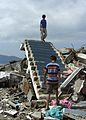 US Navy 050114-N-6817C-261 Young children of Banda Aceh, Sumatra, play on the only piece that remains of their home when a devastating tsunami hit the region Dec. 26.jpg