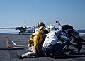 US Navy 050329-N-6484E-005 Flight deck personnel act as safety observers while distinguished visitors watch an F-14D Tomcat launch off the flight deck.jpg