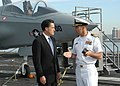 US Navy 050520-N-4549D-002 USS John F. Kennedy (CV 67) Commanding Officer, Capt. Dennis E. Fitzpatrick, gives the Massachusetts Gov. Mitt Romney a tour of the conventionally powered aircraft carrier's flight deck.jpg