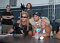 US Navy 050520-N-4843B-035 Reality television star of, The Bounty Hunter, Duane Lee Chapman and wife Beth took time to sign autographs and pose for pictures during their visit aboard the nuclear-powered aircraft carrier USS Nim.jpg