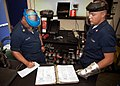 US Navy 050830-N-5134J-001 Aircrew Survival Equipmentman 1st Class, Dominic Peacock and Aircrew Survival Equipmentman 2nd Class, Paryl Blanchard, prepare to recharge a CO2 bottle.jpg
