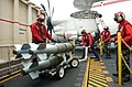 US Navy 051115-N-6484E-011 Aviation Ordnancemen place a weapons cart of GBU-38 500-pound satellite guided bombs on an ordnance elevator.jpg