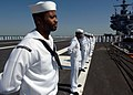 US Navy 060502-N-9254J-107 Sailors man the rails on the flight deck of the nuclear-powered aircraft carrier USS Enterprise CVN 65.jpg