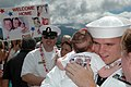 US Navy 060905-N-4965F-009 Sailors assigned to guided missile destroyer USS Russell (DDG 59) re-unite with friends and family members after returning from a six-month deployment.jpg