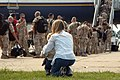 US Navy 060908-N-1331S-004 A mother holds on to her son, as they watch her husband, Lt. Cmdr. Louis Gabe depart from the AMC Terminal at Naval Station Norfolk.jpg