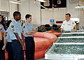 US Navy 070430-N-7427G-001 Aircrew Survival Equipmentman Shawn Parra demonstrates various life-saving gear during a visit by the Eisenhower Sea Cadet Unit from Avondale, La.jpg