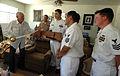 US Navy 070831-N-8146B-001 Chief petty officer selectees from amphibious assault ship USS Boxer (LHD 4) present Medal of Honor recipient John Finn with a cutlass during a visit to Finn's Southern California home.jpg