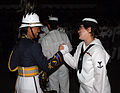 US Navy 070907-N-5174T-002 Musician 3rd Class Helena Giamarco, a Pacific Fleet band member, says goodbye to a friend from the Philippine Air Force Band following the second night of performances at the Kuala Lumpur Internationa.jpg