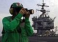 US Navy 071123-N-6524M-003 Mass Communication Specialist 3rd Class Noe Solis photographs personnel working on the flight deck aboard the nuclear-powered aircraft carrier USS Enterprise (CVN 65).jpg