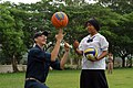 US Navy 080616-N-3581D-208 Ensign Ian Hochstein, assigned to the frigate USS Ford (FFG 54), teaches a young girl to spin a basketball at the Ban Kao Chan Primary School in Sattahip.jpg