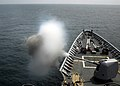 US Navy 080727-N-4236E-155 A 5-inch MK-45 Mod 2 light weight gun fires during a live fire exercise aboard the guided-missile cruiser USS Vella Gulf (CG 72).jpg