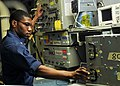 US Navy 080731-N-7981E-160 Aviation Electronics Technician 1st Class Maurice Fields, from Rochester, N.Y., conducts a performance standard test on an AQS-13F Sonar System aboard the Nimitz-class aircraft carrier USS Abraham Lin.jpg