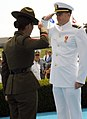 US Navy 080829-N-8848T-907 Ensign Brandon Boyles, from Charleston, S. C., receives a first salute from his Drill Instructor Gunnery Sgt. Sandra Center.jpg