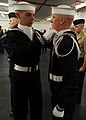 US Navy 090108-N-7948R-006 ailors assigned to the U.S. Navy Ceremonial Guard headquarters help each other prepare for a uniform inspection.jpg