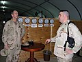US Navy 090120-N-1469M-019 Chief Personnel Specialist Kourtney Salt discusses administrative in-processing procedures for individual augmentees with Adm. Jonathan W. Greenert.jpg