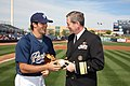 US Navy 090306-N-3271W-040 San Diego Padres pitcher Mitch Canham signs a baseball for Rear Adm. Leendert R. Hering Sr., commander of Navy Region Southwest after Hering threw the first pitch at a pre-season game.jpg