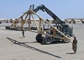 US Navy 090429-N-9410R-002 Seabees assigned to Naval Mobile Construction Battalion (NMCB) 5 use a sky track fork lift to transport trusses during the Marine expeditionary brigade building project.jpg