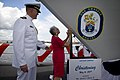 US Navy 090516-N-5549O-202 Ship's sponsor Alma Bernice Clark Gravely, wife of the late Vice Admiral Samuel L. Gravely, escorted by Cmdr. Douglas Kunzman, commanding officer of the Arleigh Burke-class destroyer Gravely (DDG-107).jpg