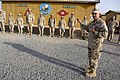 US Navy 090907-N-9818V-098 Master Chief Petty Officer of the Navy (MCPON) Rick West addresses Seabees at an awards ceremony after pinning the Seabee Combat Warfare insignia to nine newly-qualified Sailors at Camp Morrell.jpg
