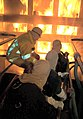 US Navy 100125-N-9531K-001 Submarine Sailors train in firefighting.jpg