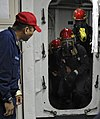 US Navy 100721-N-7280V-269 Machinist's Mate 1st Class Roberto Deguzman, a damage control training team member aboard the U.S. 7th Fleet command ship USS Blue Ridge (LCC 19).jpg
