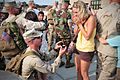 US Navy 100804-N-7367K-005 Equipment Operator Constructionman Apprentice Jon Sanders, assigned to Naval Mobile Construction Battalion (NMCB) 133, proposes to his girlfriend during a homecoming celebration.jpg