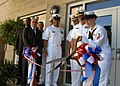 US Navy 100910-N-5700G-054 ireman Ashley Wood, assigned to the guided-missile destroyer USS McFaul (DDG 74), cuts the ribbon marking.jpg