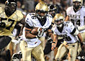 US Navy 101009-N-9936B-139 U.S. Naval Academy slot back Aaron Santiago carries the ball during the first-half of an NCAA college football game betw.jpg