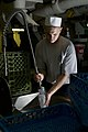 US Navy 110130-N-7488A-004 Aviation Ordnanceman Airman Johnny-Ryan Jansen washes dishes in the scullery aboard the Nimitz-class aircraft carrier US.jpg