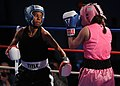 US Navy 110215-N-2610F-097 Master-at-Arms Seaman Rhonda McGee, left, spars with Patricia Cuevas during an exhibition match in the preliminary round.jpg