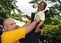 US Navy 110323-N-5085J-436 Navy Counselor 1st Class David Ferguson lifts a student during a community service project at La Briquetterie Government.jpg