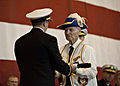 US Navy 111029-N-NY820-138 World War II submarine veteran Joe Cox passes the long glass to set the first watch during the commissioning ceremony f.jpg