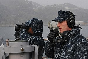 US Navy 120124-N-MU720-091 Culinary Specialist 1st Class Montreon Smith and Mineman Seaman Kyle Walker stand forward lookout watch as the ship depa.jpg