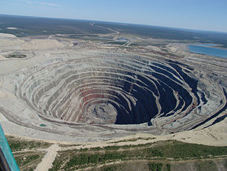 Natural resource - A picture of the Udachnaya pipe, an open-pit diamond mine in Siberia. An example of a non-renewable natural resource.