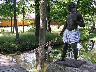 """Blackamoor (decorative arts) - A typical blackamoor sculpture in a servant-role """"holding"""" Morianbron (Blackamoor Bridge) in Ulriksdal Palace, Sweden."""