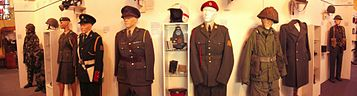 Uniforms on display in the museum.